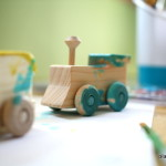 Assembling and Painting Wooden Trains with My Toddler