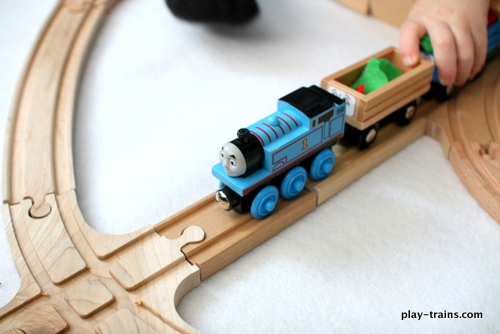 Thomas Gets a Snowplow @ Play Trains!  Playing the book on a wooden train layout my preschooler and I planned after reading it.  Lots of opportunities to discuss the different elements of a story and how to bring them to life.