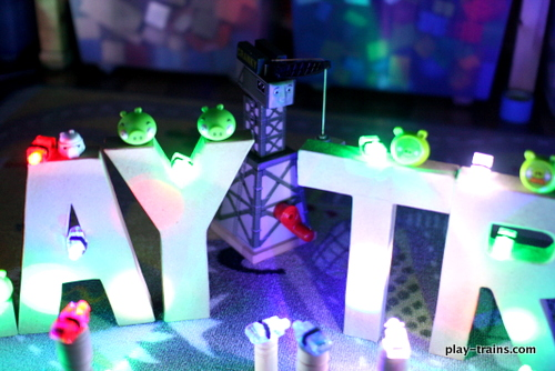 """Angry Birds Space Letter and Word Crash with Thomas and Cranky the Crane @ Play Trains!  We've added lights, 3D cardboard letters, and a few good friends to our """"live action"""" Angry Birds games, as the Little Engineer calls them, and it's fun for the whole family!"""