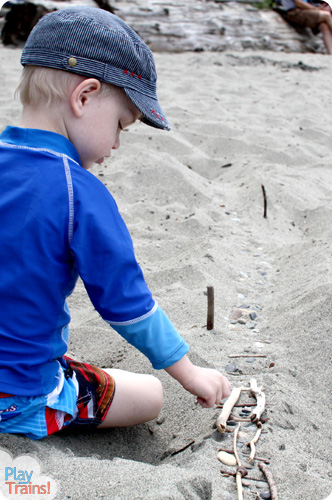 Sand Tracks: Learning with Trains at the Beach @ Play Trains! This activity combines art, science, and sensory play, demonstrating one of the technical pages between chapters in the first book of the Peter's Railway series.  These books are perfect for train-loving children of any age!