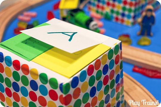 Candy Train Game from Play Trains! An open-ended counting and letter-recognition game to play with toy trains.