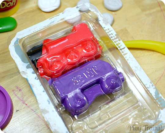 Recycled Play Dough Molds from Play Trains! A great way to reuse toy packaging after Christmas or birthday presents are unwrapped.
