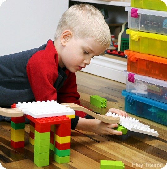 When Dreamup Toys sent us these building toys that connect wooden train tracks to interlocking building blocks to review, I knew they'd be cool, but I had no idea how much they'd supercharge my son's creativity!