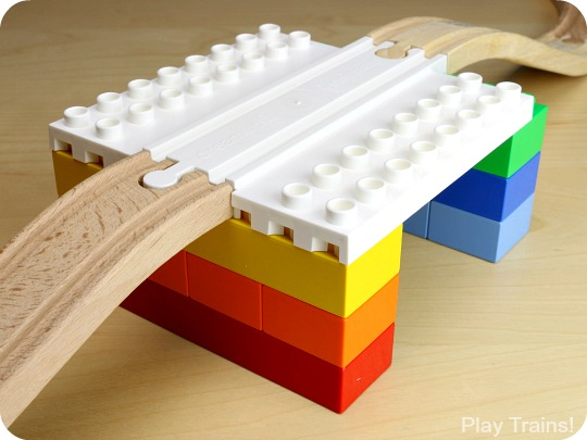 ... wooden train track and DUPLO, LEGO, or other interlocking building