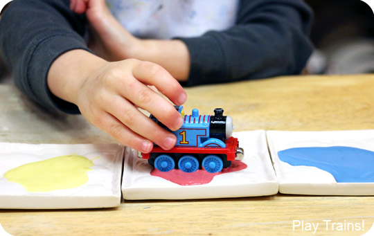 Painting with Trains: a Kid-made Thomas the Tank Engine Candy Cane Christmas Ornament -- including tips for painting with trains at a paint-your-own-pottery shop!