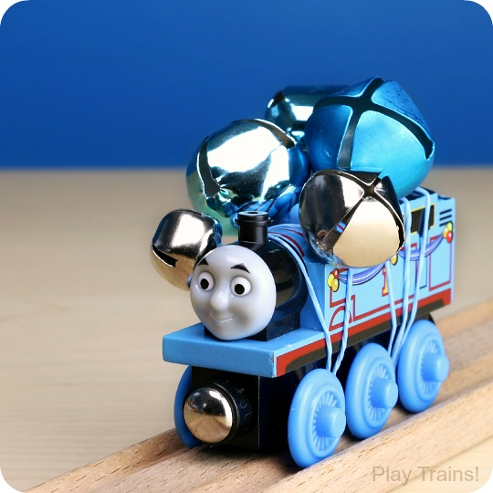 Jingle Trains: how to temporarily turn wooden trains into wooden train jingle bell shakers! Fun for ringing along with Christmas carols or for music activities all year long. http://play-trains.com/