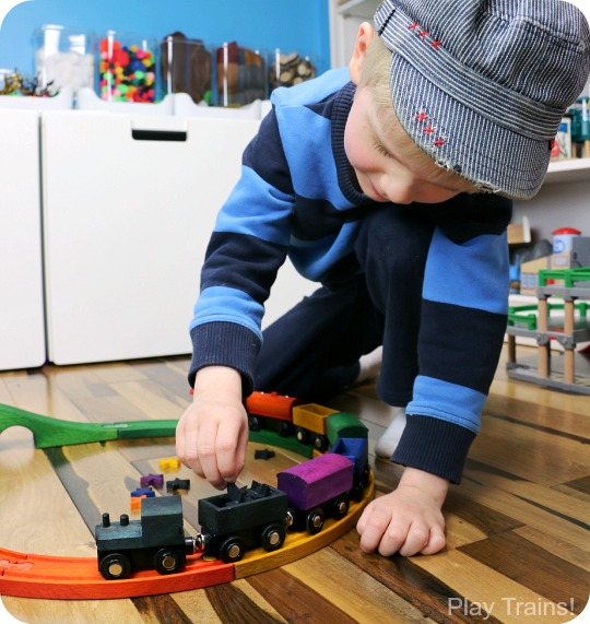 DIY Rainbow Wooden Train: beautiful, vibrant, non-toxic dye brightens up a wooden train set, inspired by the book 150+ Screen-Free Activities for Kids! Perfect for playing out the classic board book, Freight Train by Donald Crews.
