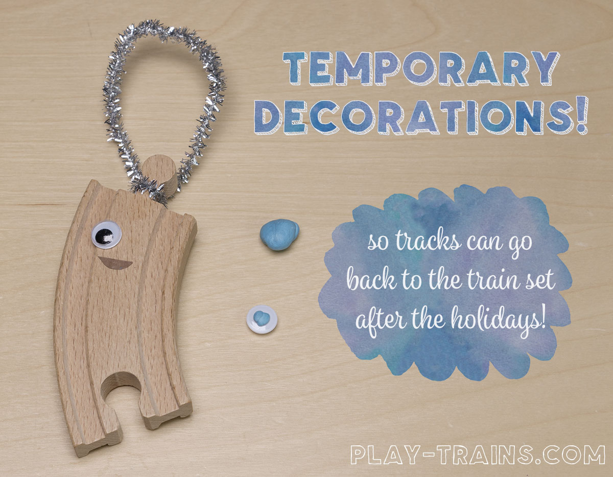DIY wooden train track Christmas ornaments inspired by OLD TRACKS, NEW TRICKS by Jessica Petersen. The decorations are temporary so the tracks can go back to the train set after the holidays!